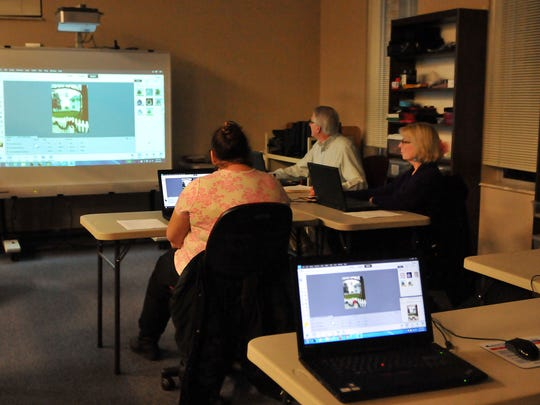 Bill Gordon leads part three of a photography and photoshop class at Ida Rupp Public Library on Wednesday evening.