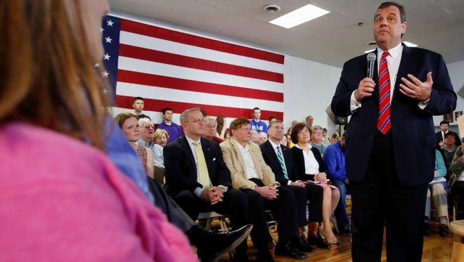 New Jersey Gov. Chris Christie takes a question during a town hall meeting with area residents in Londonderry, N.H., on Wednesday, April 15, 2015.