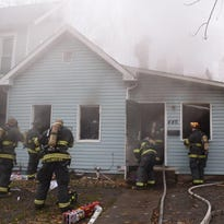 A fire displaced a family of eight living in a home in the 400 block of Parkway Avenue on Indianapolis' Near Southside on Saturday, Nov. 28, 2015. No one was injured in the fire.   A fire on the Near Southside has displaced an 8-member family.