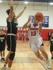 Cooper's Noah Garcia (13) drives to the basket as Lubbock