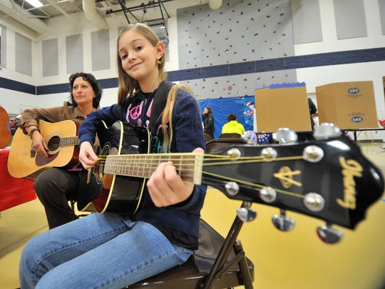 Middle school teacher Sandra Plisch, left, and Peyton Green play music during the 2014 IMAGINE event at D.C. Everest Middle School in Weston.