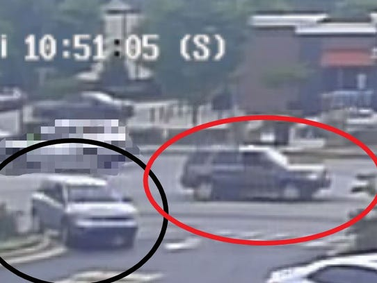 The suspect's gray SUV (red-circled) is believed to