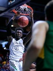 Issa Samake of Grand View Christian dunks the ball