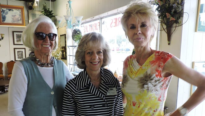 From left are Anne Schafer, Polly Campenni, vice president of Domino's, and Pat Schmader at the Sip and Shop, hosted by Cory's Furniture Collection Resale Shop to benefit Domino's Cat Rescue League.