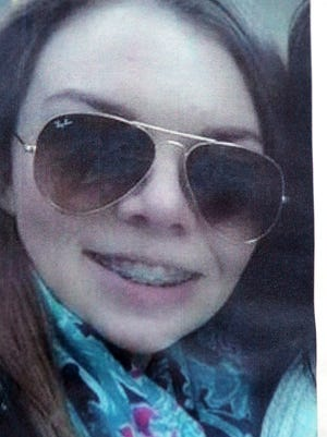 A photo of 16-year-old Grosse Pointe Woods girl Paige Stalker was stapled to a power pole at the corner of Charlevoix St. and Philip St. in Detroit, Mich. on Tuesday, December 23, 2014, one day after a gunmen opened fire on a car of teenagers that was parked near there. Stalker  was killed and three other teens were wounded in the attack, which police said did not appear to be random.