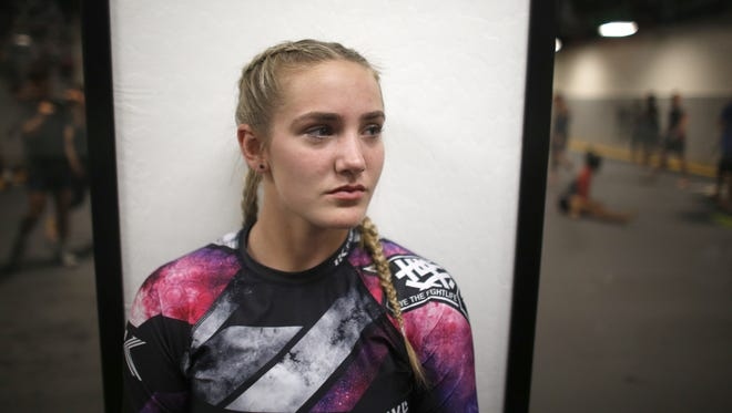 Rylee Bruce waits for class to begin at MMA Lab after school on March 21, 2018 in Phoenix, Ariz.