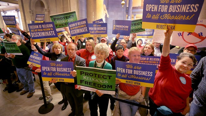 Supporters and opponents of Senate Bill 1010, the Religious Freedom bill, stand outside the House chambers while they were in session Thursday, March 19, 2015, afternoon at the Indiana State House.