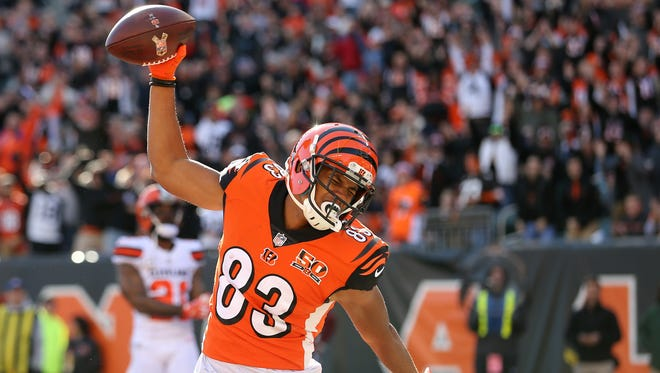 Cincinnati Bengals wide receiver Tyler Boyd (83) spikes the ball in celebration of his touchdown catch in the first quarter during the Week 12 NFL game between the Cleveland Browns and the Cincinnati Bengals, Sunday, Nov. 26, 2017, at Paul Brown Stadium in Cincinnati.