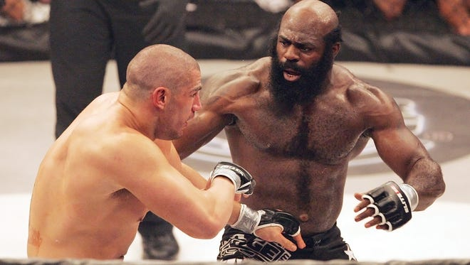 This May 31, 2008, file photo shows Kimbo Slice, right, battling James Thompson of Manchester, England during their EliteXC heavyweight bout at the Prudential Center in Newark, N.J.