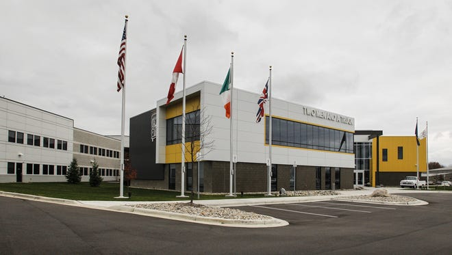 Two Men and a Truck in Lansing has outgrown its headquarters. It has leased extra office space for its growing customer relationship center.
