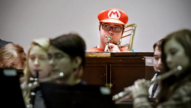 """Joe Bigelow practiced in his Mario costume while preparing for the 2015 St. Cloud State """"Halloween Spooktacular"""" concert. This year's theme is """"Heroes and Divas."""""""