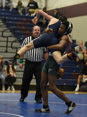 Groves' Khalil Ford (right), shown grappling with  Berkley's Frank Weiss at 130 pounds, has just one loss in his first 20 matches this season.