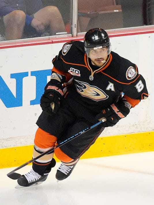 FILE - This May 16, 2014 file photo shows Anaheim Ducks right wing Teemu Selanne, of Finland, skating prior to Game 7 of an NHL hockey second-round Stanley Cup playoff series against the Los Angeles Kings in Anaheim, Calif. Selanne's family wasn't sure how he would cope this winter when he finally retired after 21 outstanding NHL seasons. Between his new restaurant, the RV trips to watch his boys' hockey games and countless hours of golf and tennis, Selanne has filled the time splendidly heading into this weekend, when the Anaheim Ducks will retire the Finnish Flash's No. 8 jersey. (AP Photo/Mark J. Terrill, File)