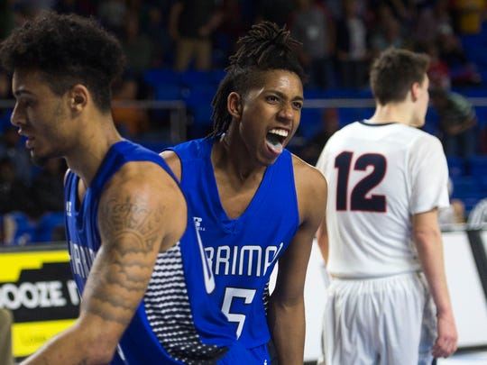 Harriman's Isaiah McClain, center, reacts as his team pulls ahead in the final seconds Friday against Columbia Academy on Friday at Middle Tennessee State University.