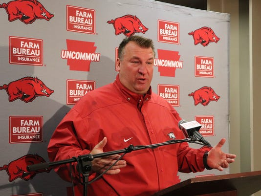 Bret Bielema speaks with reporters beneath Razorback Stadium in Fayetteville, Ark., Friday, Nov. 24, 2017, after being fired as Arkansas' football coach. Bielema said he was fired minutes after walking off the field following a 48-45 loss to Missouri dropped the Razorbacks to 4-8, 1-7 in the Southeastern Conference. (AP Photo/Kelly P. Kissel)