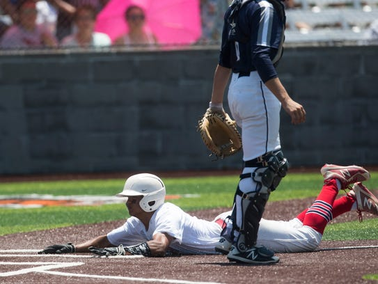 Veterans Memorial player slides into home against Boerne