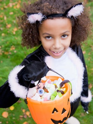 Limiting the area your kids can trick or treat in will help reduce the amount of candy they bring home.