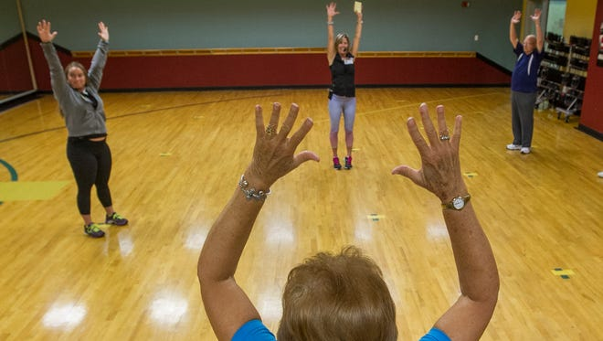 Participants take part in a morning BrainFit session at the Wellness Center in Cape Coral, Wednesday (7/20/16).  BrainFit is a 30-minute interactive class that combines basic exercises and brain training games. The goals include increasing mind-body connections and improving cognitive function.