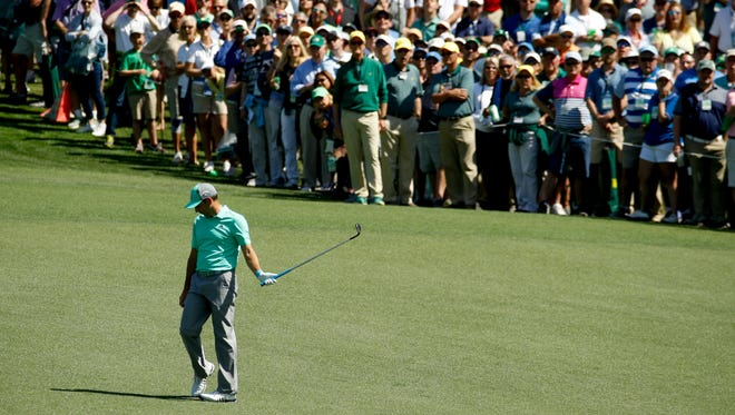 Sergio Garcia, of Spain, reacts after hitting a ball in the water on the 15th hole during the first round at the Masters golf tournament Thursday, April 5, 2018, in Augusta, Ga. Garcia shot an 8-over 13 on the hole.