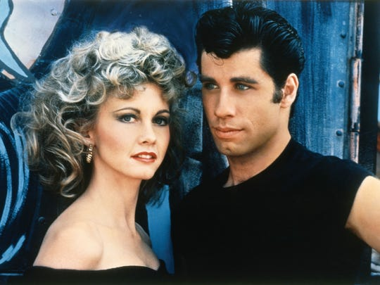 "Sandy (Olivia Newton-John) and Danny (John Travolta), happy together in ""Grease."""