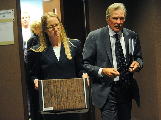 Shannon Falon, left, and Steve Johnson, laywers for Barbara and Pierce McDowell, leave a Minnehaha County courtroom after a hearing on the McDowells' neighbors' house Monday, Sept. 14, 2015, at the Minnehaha County Courthouse in Sioux Falls.