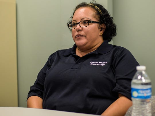 Tamika Carron, a field inspector for the state Office of Public Health, speaks about the inspection process from their office at the Clifton Chenier Center in Lafayette in August.