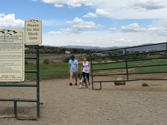 People exit the off-leash dog park at Rancho San Rafael Regional Park