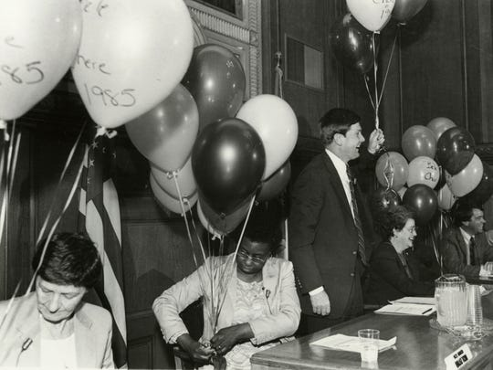 City Councilwoman Wilhelmina Bratton sits with other council members surrounded by balloons in celebration of Bele Chere in 1985.