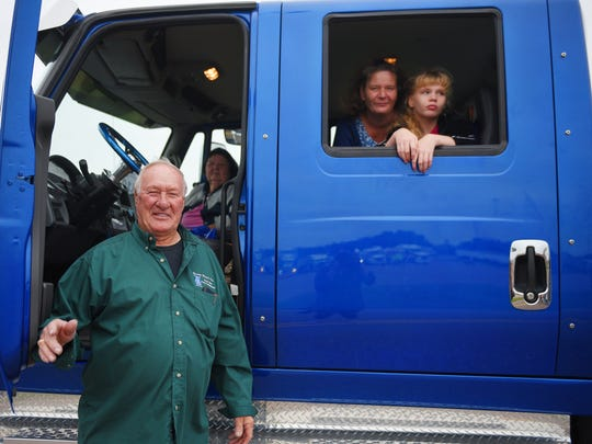 Bob Stock, left, Betty Keegan, Vicki Johnson and Harley Johnson, prepare to take off in the World's Largest Truck Convoy Saturday. Stock has been ridding with this group since 2008.