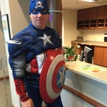 This photo from the Springfield Police Department's Facebook page shows Officer James Dougherty at his first chemo treatment, dressed as Captain America.