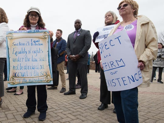 A rally for a Delaware equal rights amendment takes place on the steps of Legislative Hall in Dover on Wednesday.