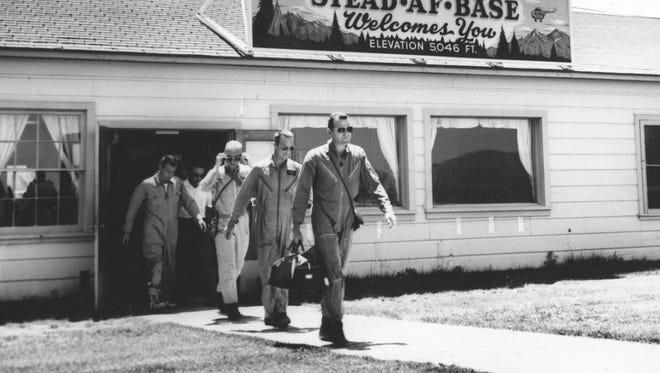 Top, astronauts Gordon Cooper, Scott Carpenter, John Glenn, Donald Slayton and Virgil Grissom leave Stead Air Force Base for desert survival training in in July 1960.