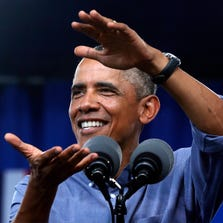 President Obama gestures as he speaks at Laborfest 2014 at Henry Maier Festival Park in Milwaukee on Labor Day.