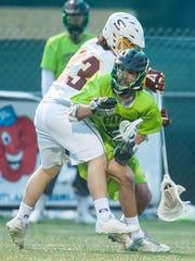 Salisbury attack Carson Kalama (23) attempts a check