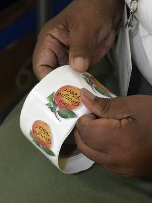 """A roll of """"I'm a Georgia Voter"""" stickers."""