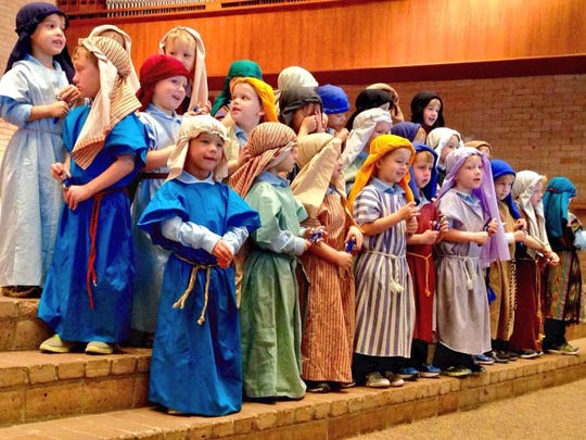 """Our Lady of Prompt Succor pre-K boys sing """"Jingle Bells"""" dressed as shepherds in a Christmas program Thursday."""