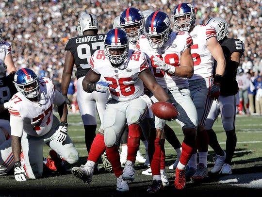 New York Giants running back Orleans Darkwa (26) celebrates