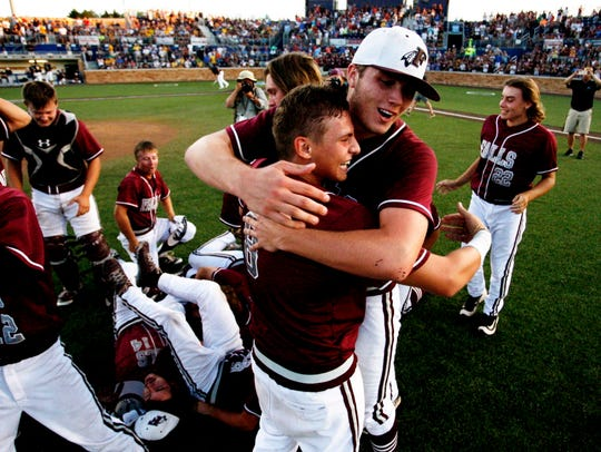 Menomonee Falls' Ty Weber (back) hugs Nick Gile after defeating Marquette during a WIAA state summer tournament in 2016.
