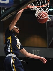 Northern Colorado's  Matej Drgon dunks the ball against
