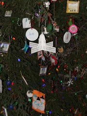 Ornaments depicting the iconic domed capitol building, state symbols, Bucky Badger and more adorned the 40-foot tall balsam fir.
