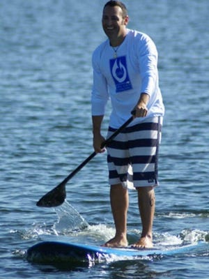 Derek Richard of Somerset will take part in the Cape Cod Bay Challenge, in which paddle boarders raise money for The Christopher Haven Foundation, which provides housing to children who have pediatric cancer and their families.