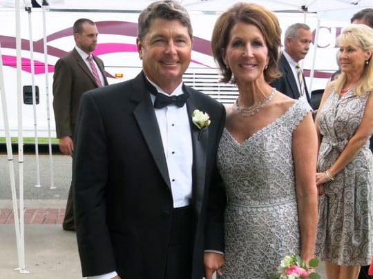 Chris and Paula Frierson, parents of bride Caroline S. Frieson arrove at tje weddomg reception.