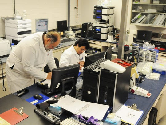 Scientists work at the Biomedical Research Foundation