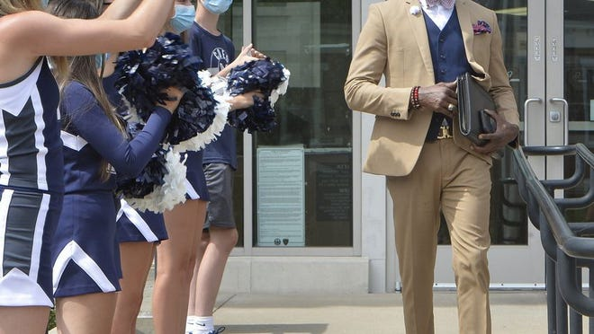McDowell High School cheerleaders greet newly-appointed Millcreek Township School District Superintendent Ian Roberts, at right, after his swearing-in ceremony at the Erie County Courthouse on Wednesday.