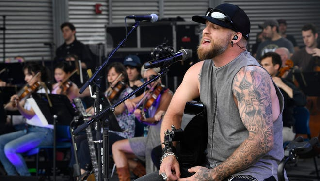 Brantley Gilbert rehearses with the symphony before the evening performance at the Ascend Amphitheater in Nashville, Tenn., Friday, May 4, 2018.