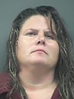 HANDOUT: The booking mug of Nemoria L. Villagomez the mother Newport Police say stabber her 6-year-old son multiple times.(Image courtesy of the Newport Police Department)