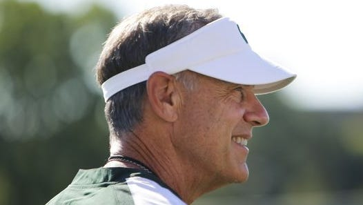 Michigan State coach Mark Dantonio watches practice on Monday, July 31, 2017, in East Lansing.