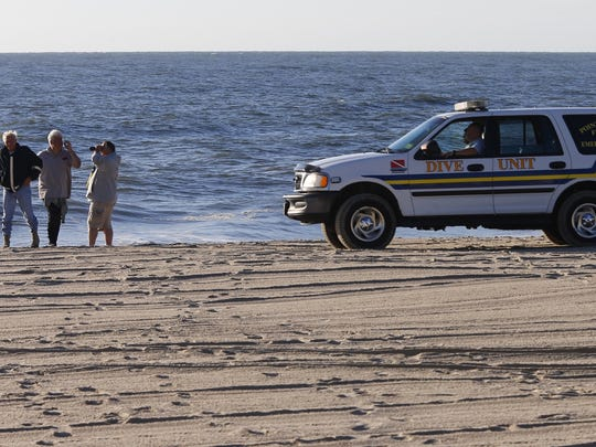 Officials continue to scan the ocean Sunday morning, July 30, 2017, for a female swimmer who alledgedly went missing overnight off Point Pleasant Beach.