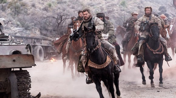 Chris Hemsworth, as Capt. Mitch Nelson, leads the charge in the film version '12 Strong' (Jan. 19).
