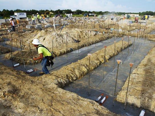 Alberto Antonio surveys the construction site of Estero